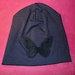 Nauja apsmukusi tamsiai melyna kepure