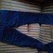 Tamsiai mėlynos spalvos džinsai