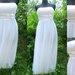 balta puosni suknele