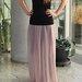 Ilgas blyškios rožinės spalvos sijonas
