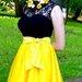 Geltonas tiulio sijonas