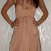 Ruda elegantiska suknele