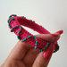 Rožinė pinta apyrankė su karoliukais