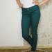 Žalios spalvos džinsai