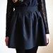 Klostuotas juodas sijonas