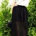 Juodas naujas sijonas