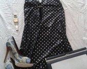 Aptempta puošni suknelė