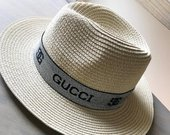 Gucci kepures skrybeles