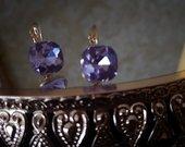 Prabangus auskariukai su violetiniu kristalu