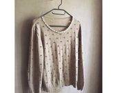 Megztinis su perlų apykakle