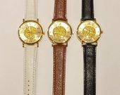 """Naujas laikrodis su """"aukso"""" dulkėmis"""