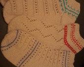 Megztos rankų darbo kojinės