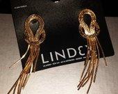 Ilgi auksiniai auskarai