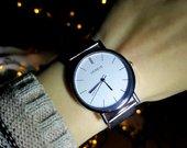 Elegantiškas sidabrinis laikrodis