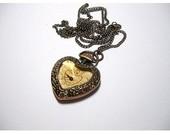laikrodukas-medalionas