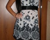 suknele balta su juodu