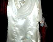 prabangi atlasine suknele