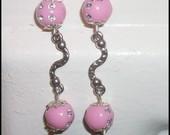 rožiniai auskariukai