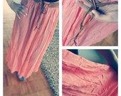 Ilgas vasarinis sijonas.