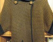 Rudai juodas megztinis