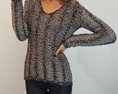 Megztinis su  žvyneliais